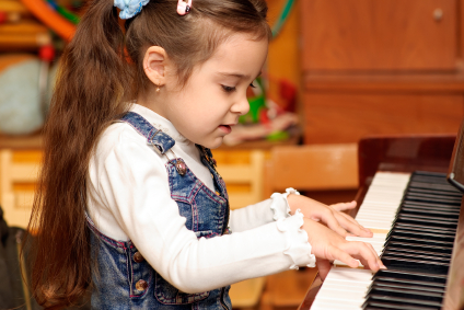 Girl plays piano